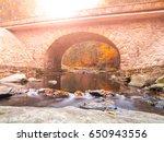 Small photo of Stone bridge over River Divoka Orlice at Zemska brana, Orlicke hory, or Eagle Mountains, Czech Republic. Autumn time.