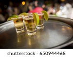 shots of tequila with lemon | Shutterstock . vector #650944468