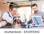 confident pleasant men working... | Shutterstock . vector #651055342