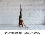 the concept of yoga. a young... | Shutterstock . vector #651071902