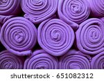 heap of rolled up bright purple ... | Shutterstock . vector #651082312