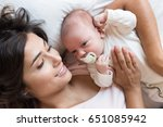 young mother with her baby in... | Shutterstock . vector #651085942