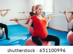 strong focused pregnant women... | Shutterstock . vector #651100996