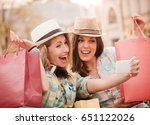 shopping. two attractive young... | Shutterstock . vector #651122026