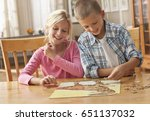 children doing puzzle at table | Shutterstock . vector #651137032