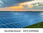 solar panels at sunrise with... | Shutterstock . vector #651144466