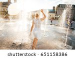 Girl In A Spray Of Water In A...