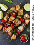 chicken kebab on skewers with... | Shutterstock . vector #651174622