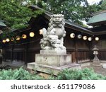 Stock photo komainu stone carved guardian dog placed at the gate of a shinto shrine in japan un gyo style 651179086