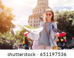 laughing woman feeding pigeons...   Shutterstock . vector #651197536