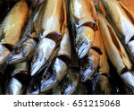 smoked fishes. pile of smoked... | Shutterstock . vector #651215068