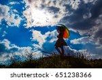 umbrella and pretty girl... | Shutterstock . vector #651238366