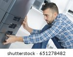 man fixing cartridge in printer ... | Shutterstock . vector #651278482