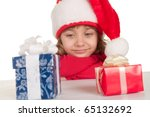 Little girl with Christmas presents - stock photo