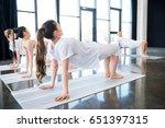 young women doing half wheel... | Shutterstock . vector #651397315