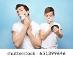 father and son shaving on light ... | Shutterstock . vector #651399646