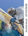 Stock photo aircraft painting and sandblasting 651425608