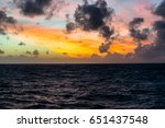 sunset with blue and orange sky ... | Shutterstock . vector #651437548