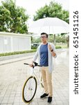 Vietnamese Man With Bicycle An...