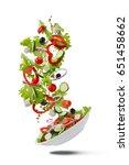 flying greek salad for on white ...   Shutterstock . vector #651458662