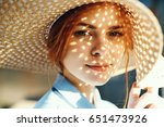 portrait of a woman in a hat  a ... | Shutterstock . vector #651473926