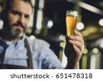 male brewery worker examining... | Shutterstock . vector #651478318