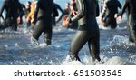 triathletes running out of the... | Shutterstock . vector #651503545