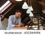 smiling man sending text... | Shutterstock . vector #651564496