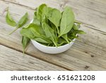spinach in a white bowl on a... | Shutterstock . vector #651621208