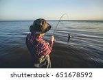 a fisherman with a fishing rod... | Shutterstock . vector #651678592