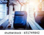 traveler with luggage on moving ... | Shutterstock . vector #651749842