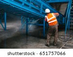 the worker washes the equipment ... | Shutterstock . vector #651757066