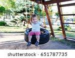 Girl Sitting On Tire Swing