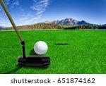 golfer using a putter club to...   Shutterstock . vector #651874162