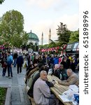 Small photo of ISTANBUL, TURKEY - MAY 28, 2017: The Muslims waiting for the adhan (ezan) and evening meal (Iftar) after the sunset in Ramadan in front of Hagia Sophia in Sultan Ahmet Park, Istanbul, Turkey
