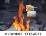 Marshmallows Roasting Over An...