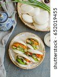 Small photo of Japanese style steamed buns for breakfast or afternoon tea snack / Vegetarian Guo Bao / Wrapped with seaweed,egg,carrot and avocado slices,cherry tomatoes,scallions,sesame seeds,tahini and soy sauce