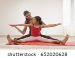 mother and daughter doing yoga...   Shutterstock . vector #652020628