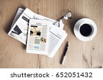 newspaper with tablet on wooden ... | Shutterstock . vector #652051432