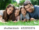happy family outdoors  | Shutterstock . vector #652053376