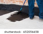 worker covered surface  bitumen ... | Shutterstock . vector #652056658