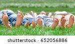 family feet on grass  | Shutterstock . vector #652056886