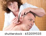 professional acupuncture session | Shutterstock . vector #652059535