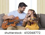 father and daughter singing... | Shutterstock . vector #652068772