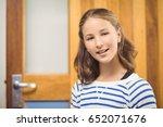 portrait of smiling schoolgirl... | Shutterstock . vector #652071676