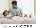 father checking temperature of... | Shutterstock . vector #652074532