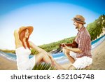 summer day on beach and two... | Shutterstock . vector #652104748
