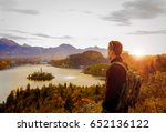 young hiker carrying backpack... | Shutterstock . vector #652136122