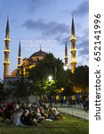 Small photo of ISTANBUL, TURKEY - MAY 28, 2017: The Muslims waiting for the adhan (azan) and evening meal (Iftar) after the sunset in Ramadan in front of Blue Mosque in Sultan Ahmet Park, Istanbul, Turkey