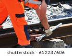 Railroad Worker Fixes Two...